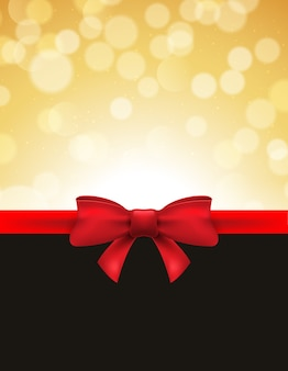 Weihnachtsdefokussierter bokehhintergrund mit roter schleife. geschenkkarte feiertagsfeier einladung weihnachten.
