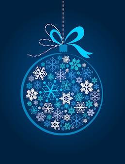 Weihnachtsdekoration aus vielen schneeflocken auf einem dunkelblauen hintergrund
