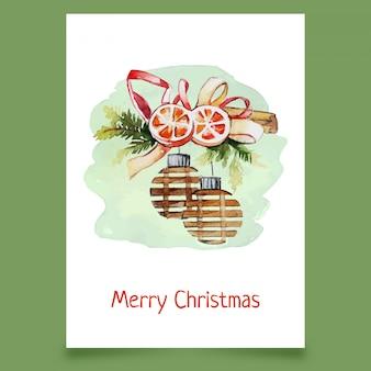 Weihnachtsdekoration mit kugeln, orange scheiben und farbband