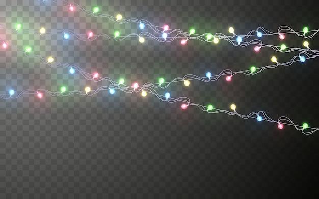 Weihnachtsfarbe girlande, festliche dekorationen. glühende weihnachtslichter transparente effektdekoration auf dunklem hintergrund.
