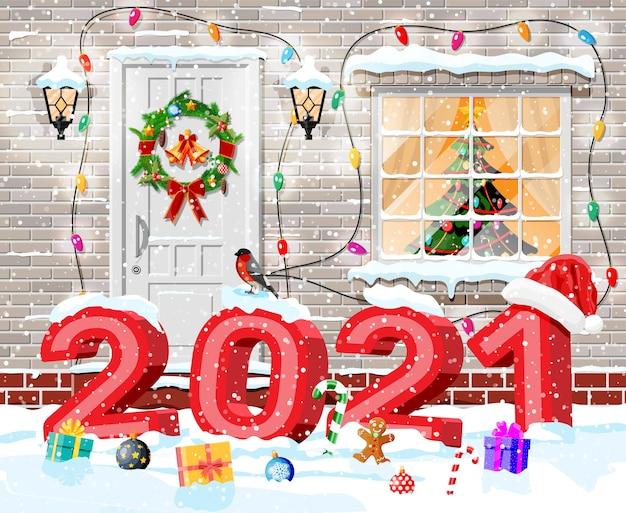Weihnachtsfassadendekoration mit 2021 fetten buchstaben