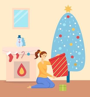 Weihnachtsfeier zu hause, frau mit geschenken