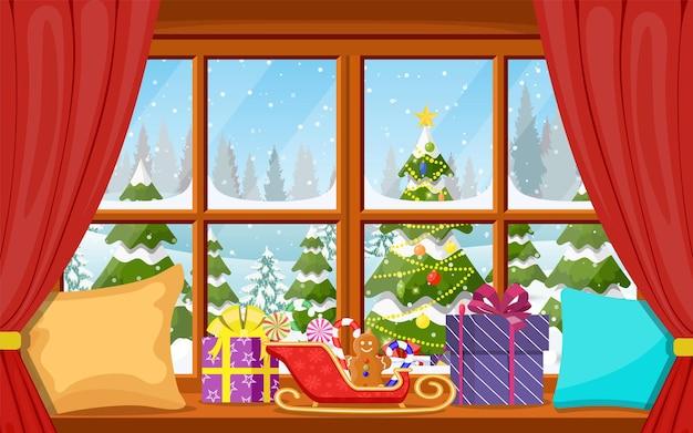 Weihnachtsfensteransicht mit verschneiter landschaft