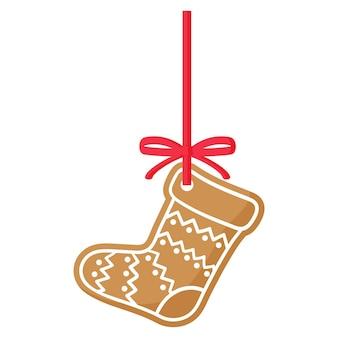 Weihnachtsfestlicher stiefel-lebkuchenplätzchen bedeckt von weißer zuckerglasur mit rotem band. frohe weihnachten und ein glückliches neues jahr-konzept.
