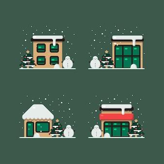 Weihnachtsgebäude im winterschnee, komplett mit weihnachtskiefer und schneemanndekoration auf hof.