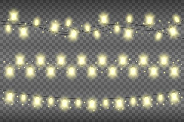 Weihnachtsgelbe realistische girlandenlichter auf einem transparenten hintergrund. leuchtende girlande lichter dekoration mit glitzern