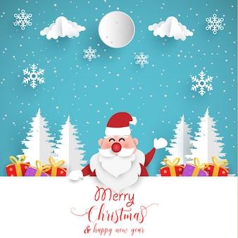 Weihnachtsgeschenk mit santa claus. papierkunstentwurf