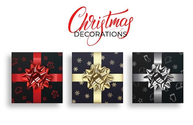 Weihnachtsgeschenke mit glänzenden realistischen bögen. winterurlaub dekorationen festgelegt