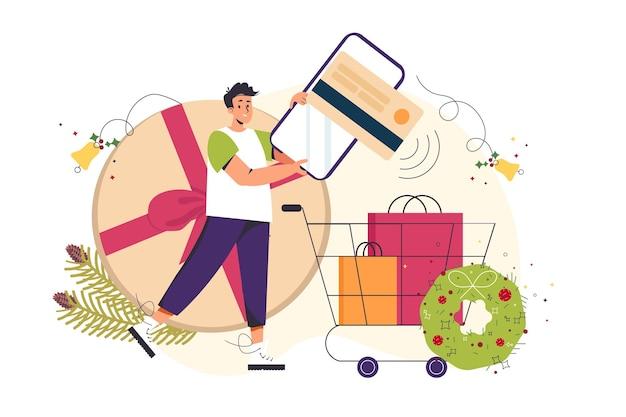 Weihnachtsgeschenke online bestellen mann, der handy und wagen mit einkäufen hält online-shopping-konzept