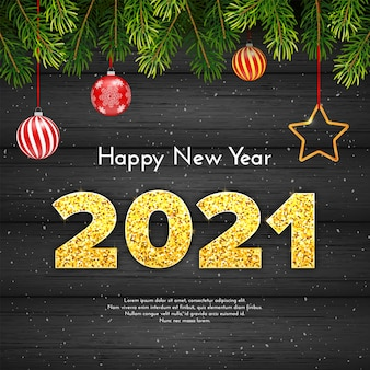 Weihnachtsgeschenkkarte frohes neues jahr mit tannenzweigen. goldene funkelnde zahlen 2021