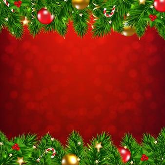 Weihnachtsgirlande mit weihnachtskugeln und dekorationen