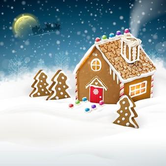 Weihnachtsgruß lebkuchenhaus über schneefeld