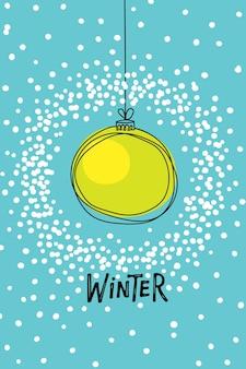 Weihnachtsgrußkarte mit gelber weihnachtskugel im schneerahmen wintertext auf blauem hintergrund