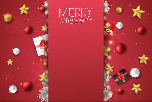 Weihnachtsgrußkarte mit roten und goldenen kugeln und sternen