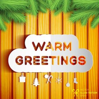 Weihnachtsgrußschablone mit den grünen tannenzweigen des papierdekorationselements auf hölzerner illustration