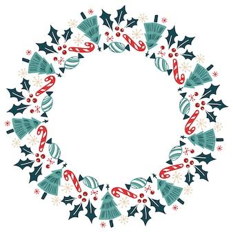 Weihnachtshand gezeichneter kranz-vektor