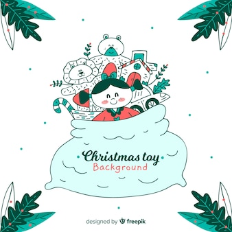 Weihnachtshand gezeichneter spielzeughintergrund