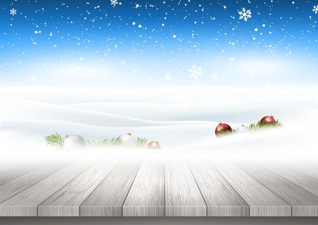 Weihnachtshintergrund mit dem holztisch, der heraus zur schneebedeckten landschaft schaut