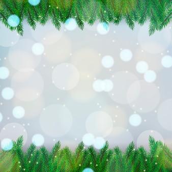 Weihnachtshintergrund mit fichtenzweigen auf einem bokeh