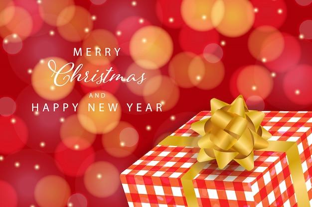 Weihnachtshintergrund mit geschenkbox und bokeh-effekt