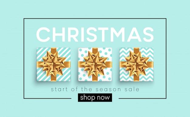 Weihnachtshintergrund mit geschenkkästen mit einem goldbogen.