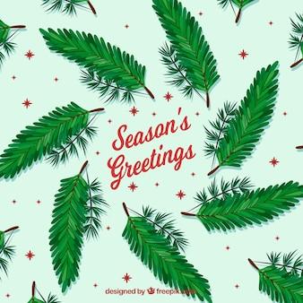 Weihnachtshintergrund mit grünen niederlassungen