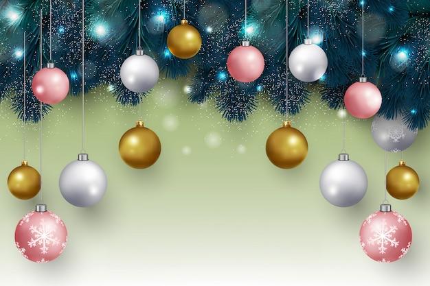 Weihnachtshintergrund mit hängenden weihnachtsbällen und tannenzweigen entwerfen vektor
