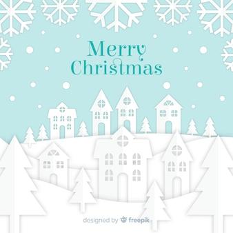 Weihnachtshintergrund mit papercut-designstadt