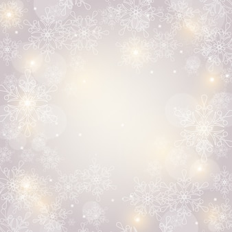 Weihnachtshintergrund mit schneeflocken und platz für text