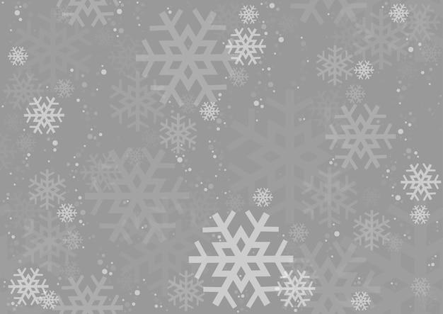 Weihnachtshintergrund von fallenden schneeflocken über grau