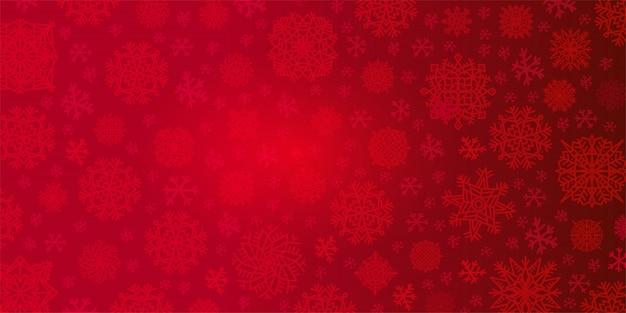 Weihnachtshintergrund von großen und kleinen schneeflocken in den roten farben