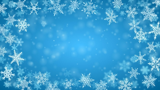 Weihnachtshintergrund von komplexen unscharfen und klar fallenden schneeflocken in hellblauen farben mit bokeh-effekt