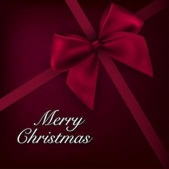Weihnachtshintergrundkarte mit rotem bogen