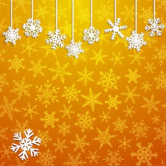 Weihnachtsillustration mit weißen hängenden schneeflocken auf goldenem hintergrund
