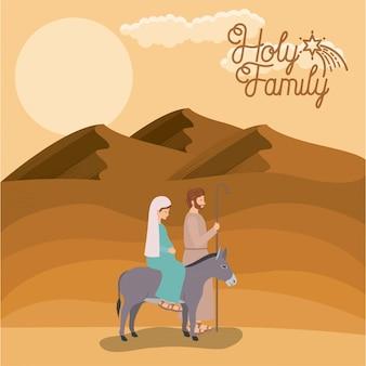 Weihnachtskarte mit der heiligen familie, die in wüste reist