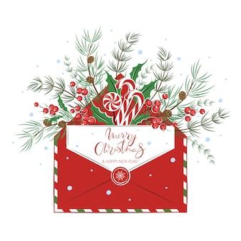 Weihnachtskarte mit umschlag mit traditionellen bonbons und dekorationen