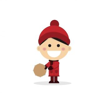 Weihnachtskind, das das Tamburin auf einem weißen Hintergrund spielt