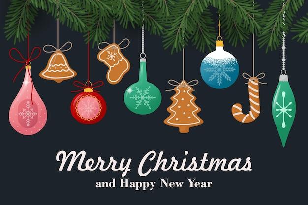 Weihnachtskomposition aus tannenzweigen beeren weihnachtsspielzeug und lebkuchenplätzchen