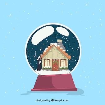 Weihnachtskonzept mit haus in der glaskugel