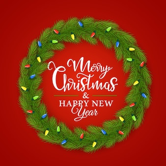 Weihnachtskranz aus tannenzweigen verziert mit einer girlande mit der aufschrift im inneren