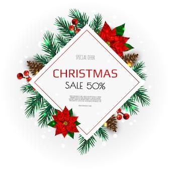 Weihnachtskranz mit tannenzweigen, beeren, weihnachtsblumen und anderen feiertagselementen.