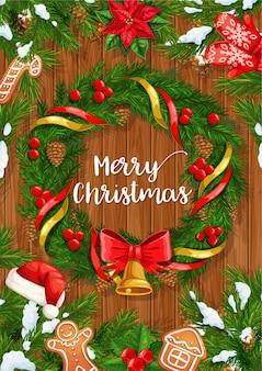 Weihnachtskranz mit weihnachtsglocke auf hölzernem hintergrundentwurf. kiefern- und stechpalmenbeerenzweige mit schnee, weihnachtsmütze und bändern, schneeflocken, roter schleife und lebkuchen, weihnachtsstern und handschuhen