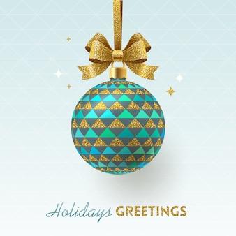 Weihnachtskugel mit geometrischem muster und glitzerndem goldbogen