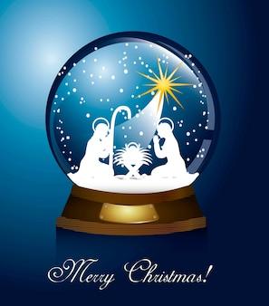 Weihnachtskugel mit krippe über blauem hintergrund