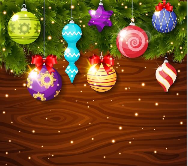 Weihnachtskugeln auf holzbrett