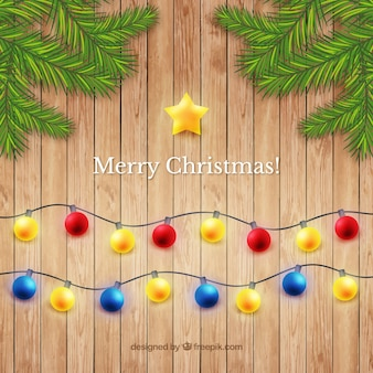 Weihnachtskugeln auf holzuntergrund