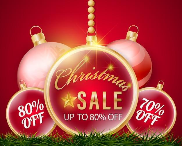Weihnachtskugeln, die verkaufsfahne und prozentsatzrabattpreis hängen