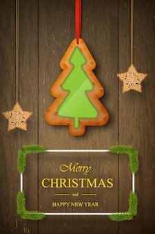 Weihnachtslebkuchen auf dunklem hölzernem mit wünschen, kiefernniederlassungen.
