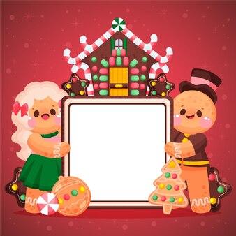 Weihnachtslebkuchenplätzchen, die leeres banner halten