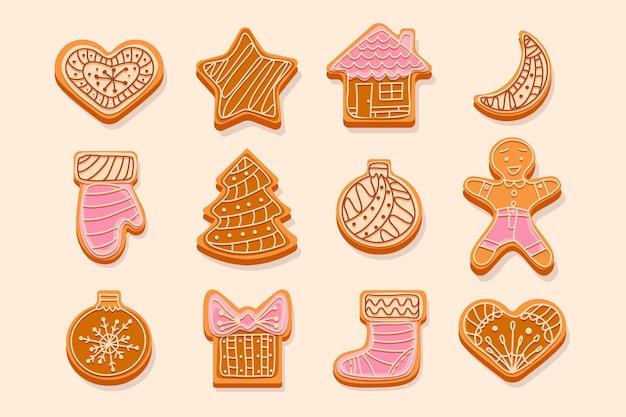 Weihnachtslebkuchenplätzchen verziert mit sahne- und glasurfiguren von weihnachtsbaumspielzeug